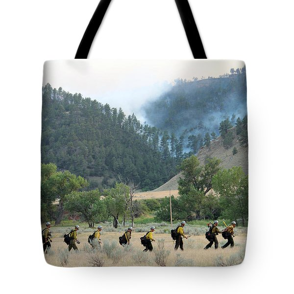 Tote Bag featuring the photograph Wyoming Hot Shots Walk To Their Assignment by Bill Gabbert