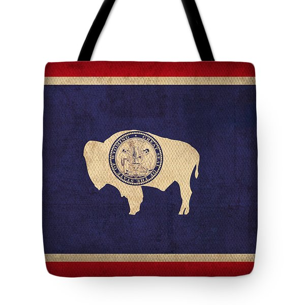 Wyoming State Flag Art On Worn Canvas Tote Bag by Design Turnpike