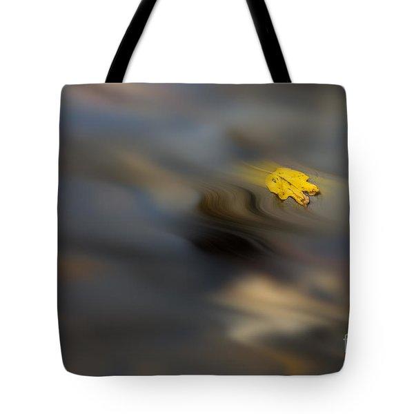 Yellow Leaf Floating In Water Tote Bag by Dan Friend