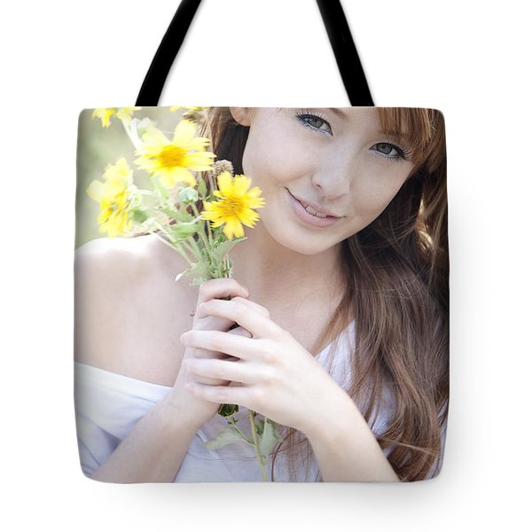 Young Woman with Flowers Tote Bag by Brandon Tabiolo