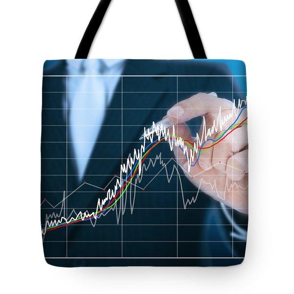 businessman writing graph of stock market  Tote Bag by Setsiri Silapasuwanchai