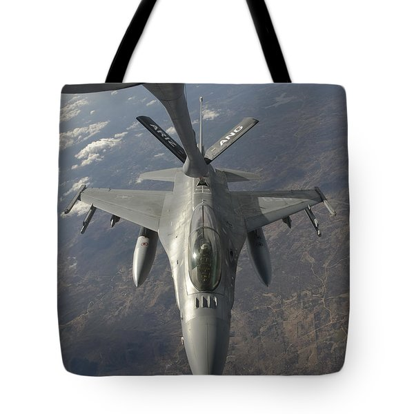 A Chilean Air Force F-16 Refuels Tote Bag by Giovanni Colla
