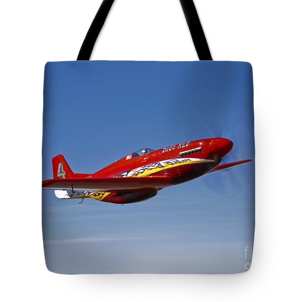 A Dago Red P-51g Mustang In Flight Tote Bag by Scott Germain