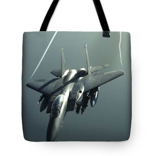 An F-15e Strike Eagle Flies Over Iraq Tote Bag by Stocktrek Images