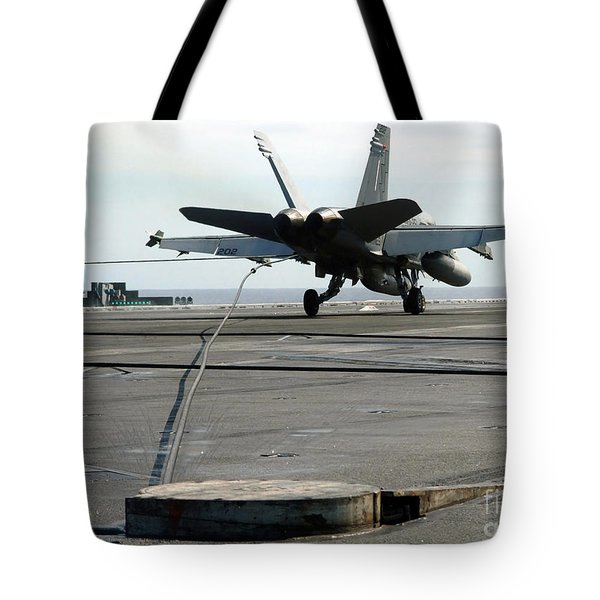An Fa-18c Hornet Makes An Arrested Tote Bag by Stocktrek Images