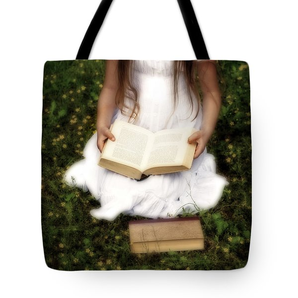 Girl Is Reading A Book Tote Bag by Joana Kruse