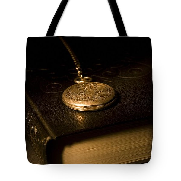 Gold Pocket Watch Resting On A Book Tote Bag by Philippe Widling