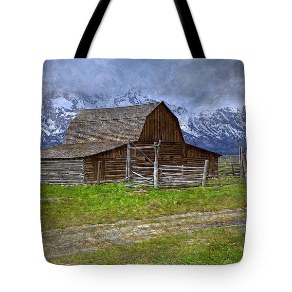 Grand Teton Iconic Mormon Barn Fence Spring Storm Clouds Tote Bag by John Stephens
