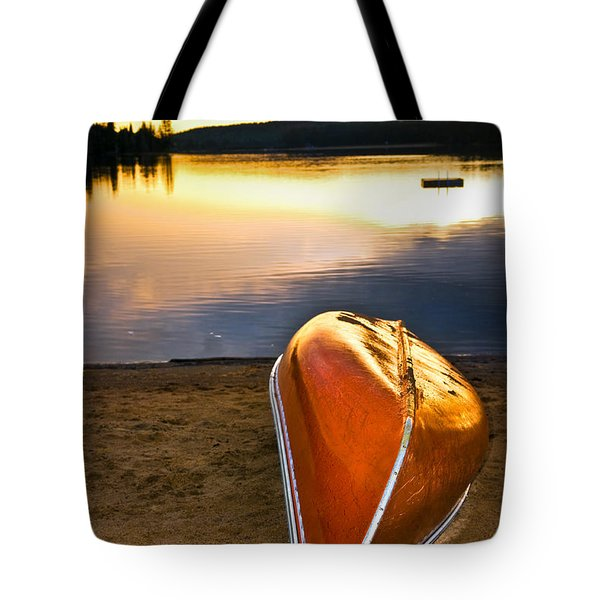Lake Sunset With Canoe On Beach Tote Bag by Elena Elisseeva