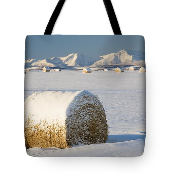 Snow-covered Hay Bales Okotoks Tote Bag by Michael Interisano