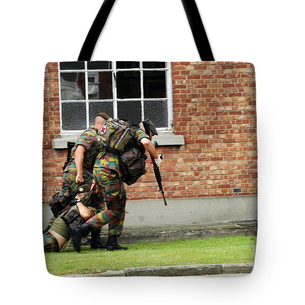 Soldiers Of The Belgian Army Helping Tote Bag by Luc De Jaeger