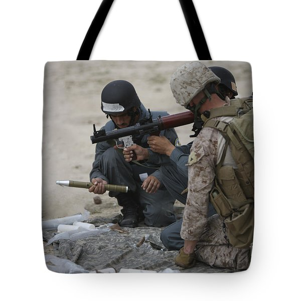 U.s. Marine Watches An Afghan Police Tote Bag by Terry Moore