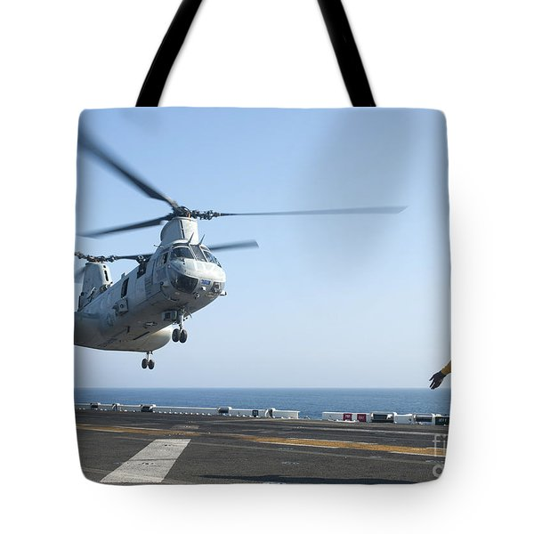 A Ch-46e Sea Knight Helicopter Prepares Tote Bag by Stocktrek Images