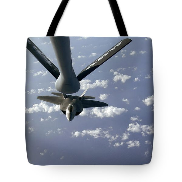 A Three Ship Formation Of F-22 Raptors Tote Bag by Stocktrek Images