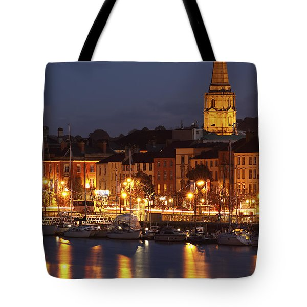 Boats Moored On River Suir At City Tote Bag by Trish Punch
