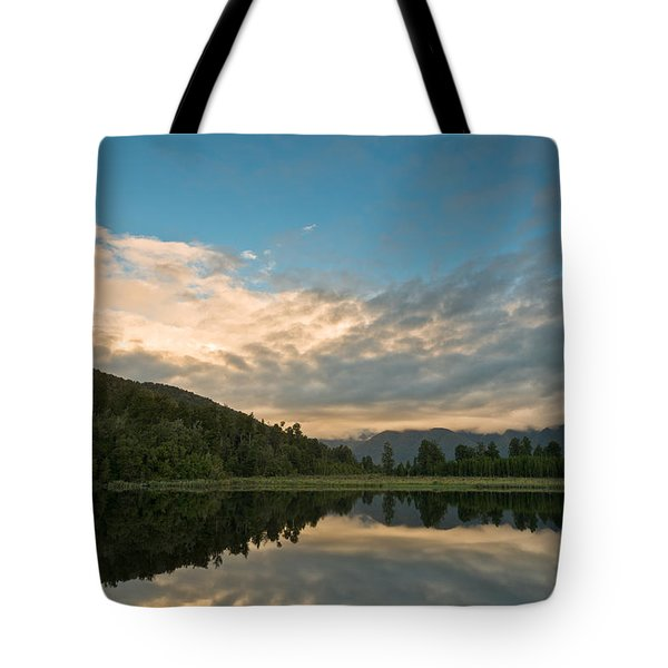 Sunrise Above A Lake On A Wind Still Morning Tote Bag by Ulrich Schade
