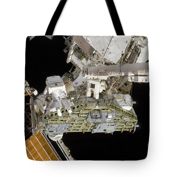 Astronauts Working On The International Tote Bag by Stocktrek Images