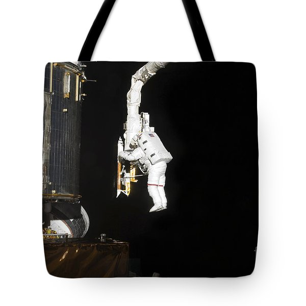 Astronaut Working On The Hubble Space Tote Bag by Stocktrek Images