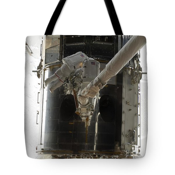 Astronauts Working On The Hubble Space Tote Bag by Stocktrek Images