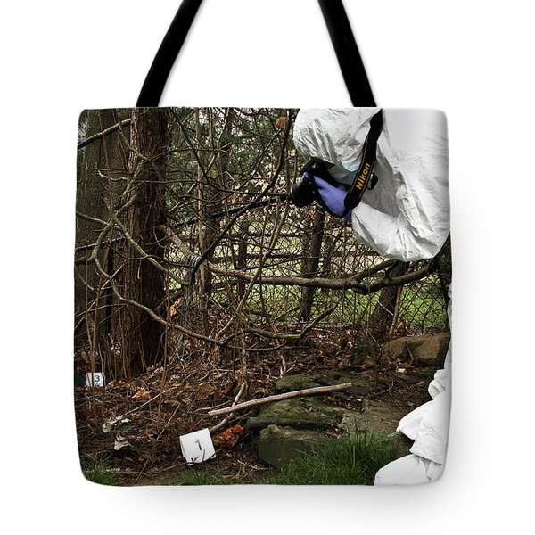 Criminal Investigation Tote Bag by Photo Researchers, Inc.