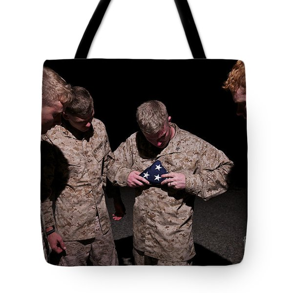 U.s. Marines Fold The American Flag Tote Bag by Terry Moore