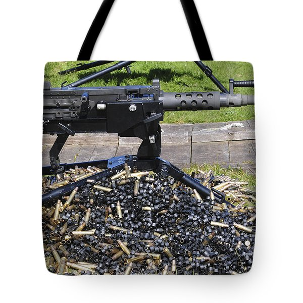 A .50 Caliber Browning Machine Gun Tote Bag by Andrew Chittock