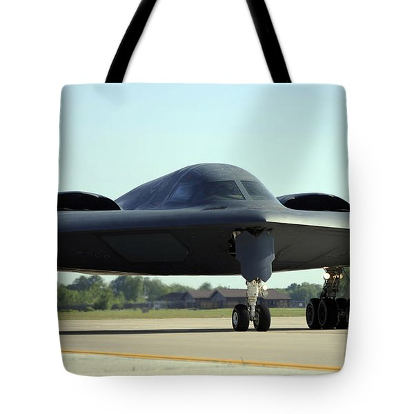 A B-2 Spirit Taxis Onto The Flightline Tote Bag by Stocktrek Images