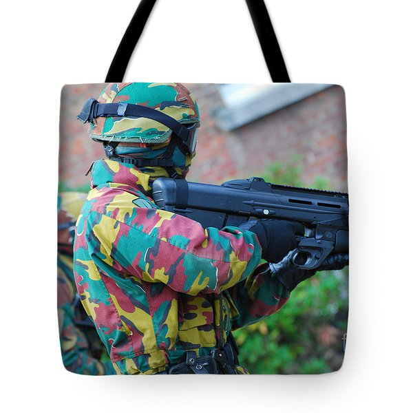 A Belgian Paratrooper  Handling The Fn Tote Bag by Luc De Jaeger