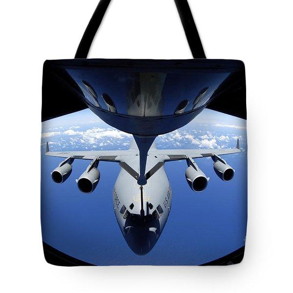 A C-17 Globemaster Iii Receives Fuel Tote Bag by Stocktrek Images