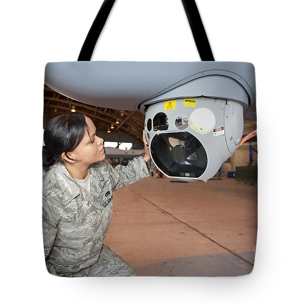 A Crew Chief Works On Mq-9 Reapers Tote Bag by HIGH-G Productions