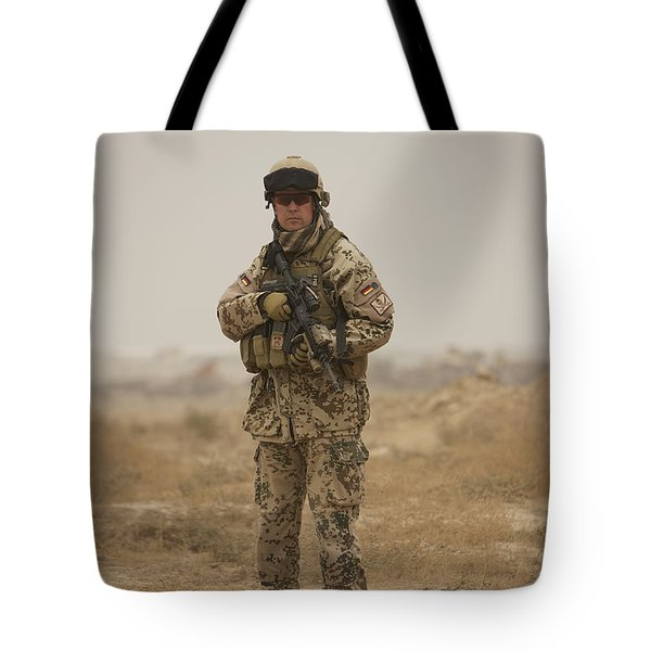 A German Army Soldier Armed With A M4 Tote Bag by Terry Moore