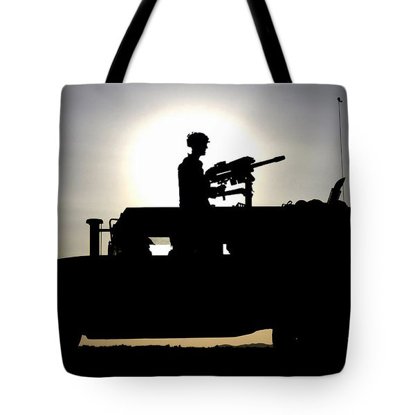 A Gunner Mans An Mk-19 40mm Machine Gun Tote Bag by Stocktrek Images