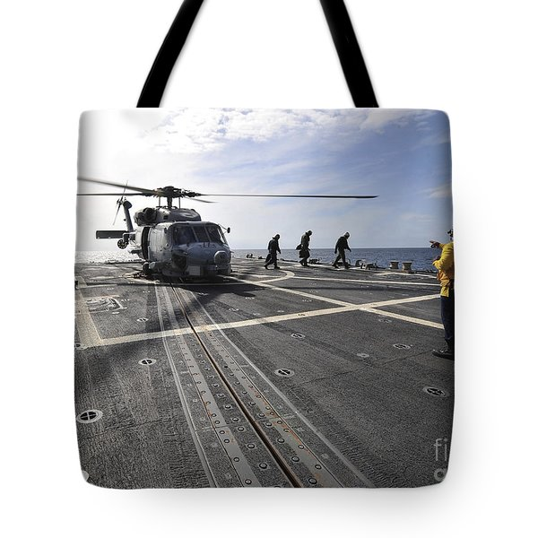 A Helicpter Sits On The Flight Deck Tote Bag by Stocktrek Images