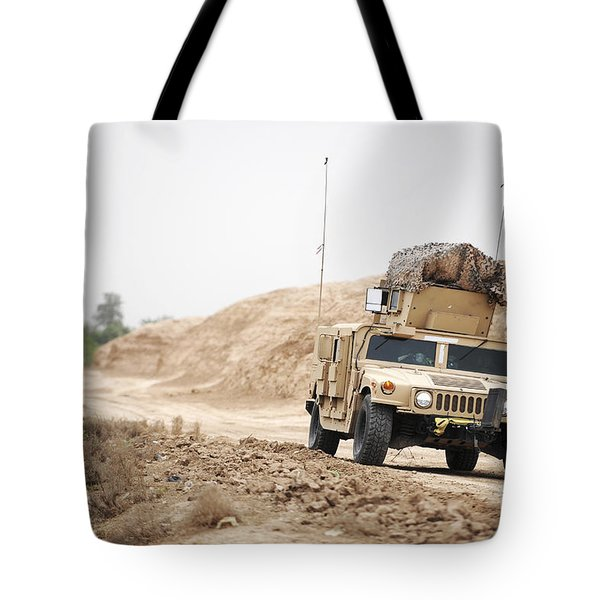 A Humvee Conducts Security Tote Bag by Stocktrek Images