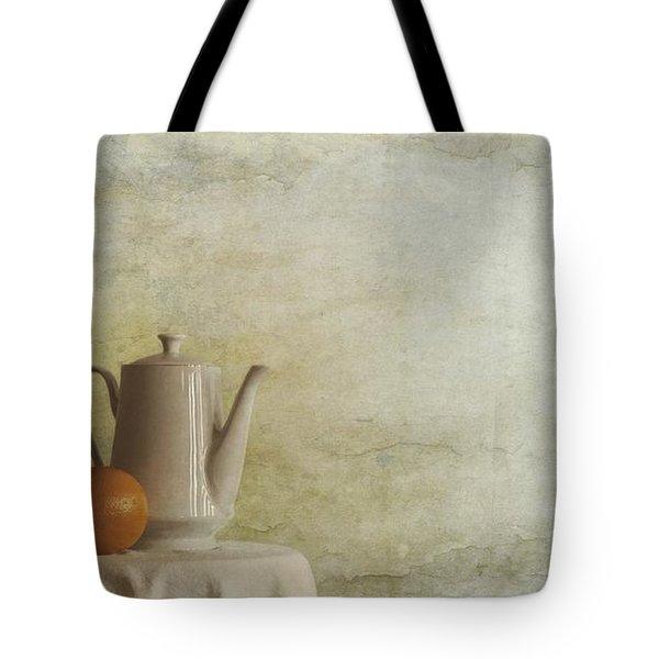 a jugful tea and a orange Tote Bag by Priska Wettstein