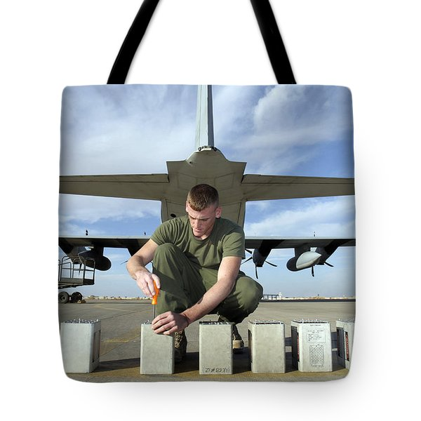 A Marine Replaces Flares In Flare Tote Bag by Stocktrek Images
