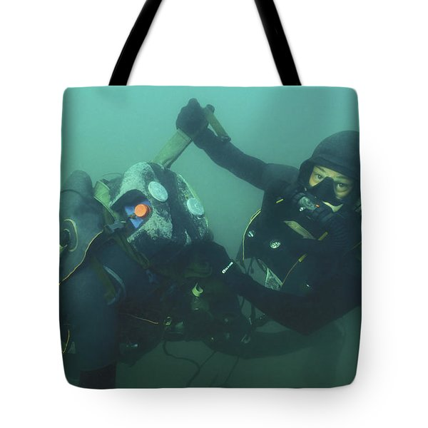 A Navy Seal Combat Swimmer Removes Tote Bag by Michael Wood