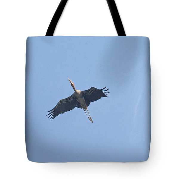 A Painted Stork Flying High In The Sky Tote Bag by Ashish Agarwal