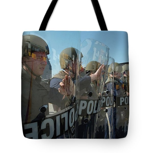 A Riot Control Team Braces Tote Bag by Stocktrek Images