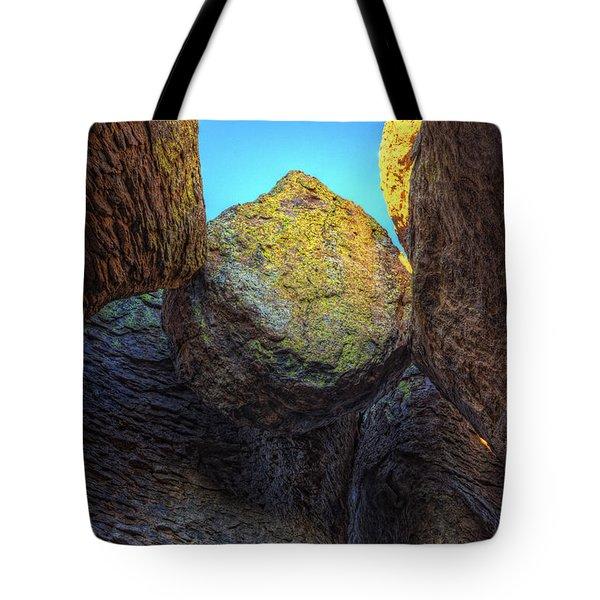 A Rock Balanced Precariously Tote Bag by Robert Postma