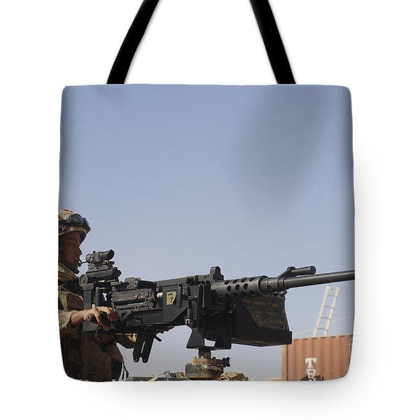 A Royal Marine Manning A .50 Caliber Tote Bag by Andrew Chittock