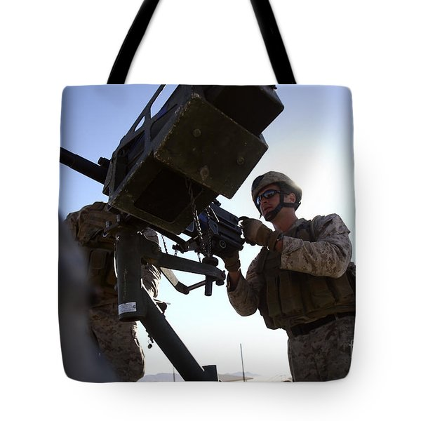 A Soldier Fires 40mm Rounds Tote Bag by Stocktrek Images