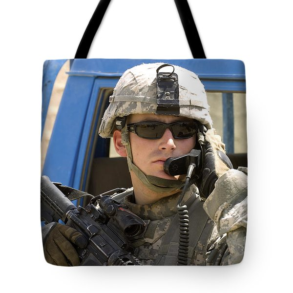 A Soldier Talking Via Radio Tote Bag by Stocktrek Images