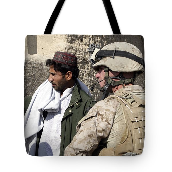 A Soldier Talks To A Local Villager Tote Bag by Stocktrek Images