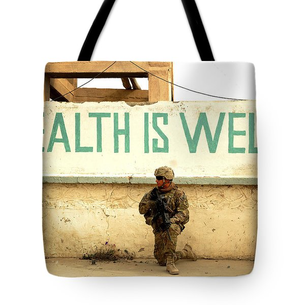 A Soldier Talks To An Afghan Boy Tote Bag by Stocktrek Images