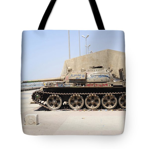 A T-55 Tank On The Seafront Tote Bag by Andrew Chittock