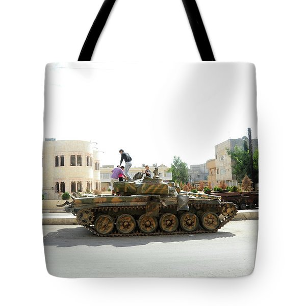 A T-72 Main Battle Tank On The Streets Tote Bag by Andrew Chittock