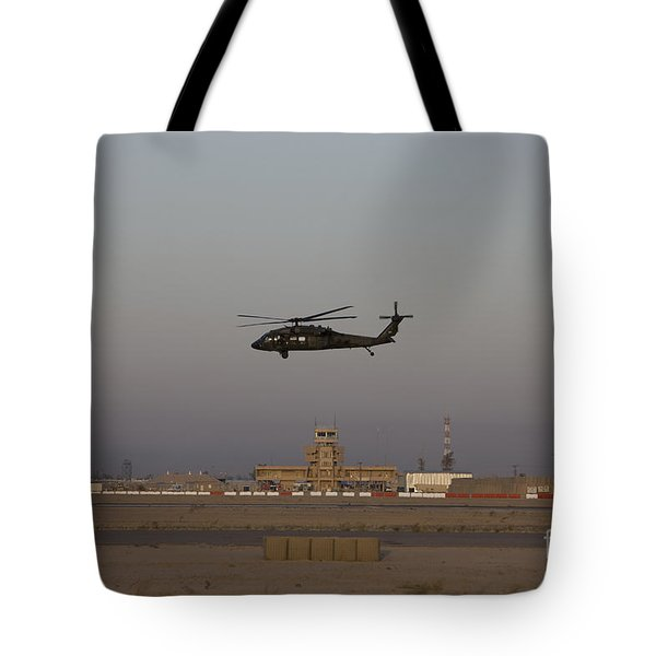 A Uh-60 Blackhawk Helicopter Flies Tote Bag by Terry Moore