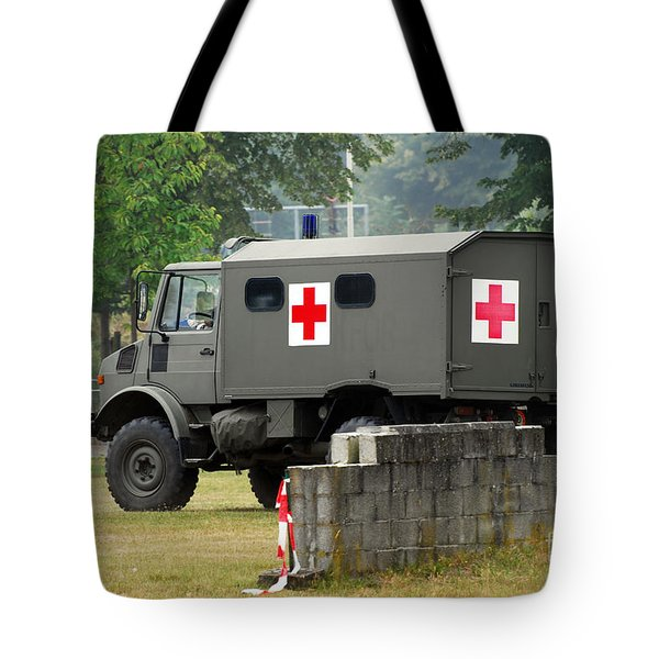 A Unimog In An Ambulance Version In Use Tote Bag by Luc De Jaeger