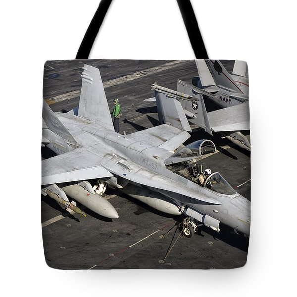 A Us Navy Fa-18c Hornet Parked Tote Bag by Giovanni Colla
